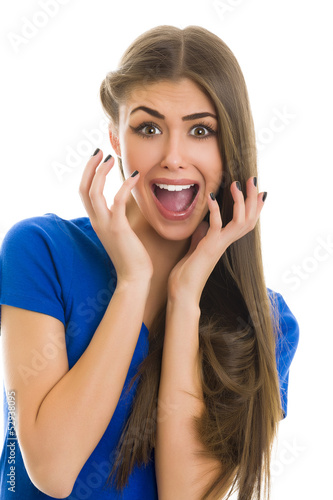 Surprise! Beautiful young woman with surprised facial expression