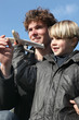 Little boy holding model plane