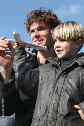 Little boy holding model plane