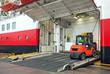 Lift truck unloads big passenger ferry through opened side ramp