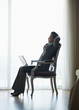 Silhouette of relaxed business woman sitting in hotel room