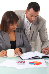 Man and woman interpreting financial results