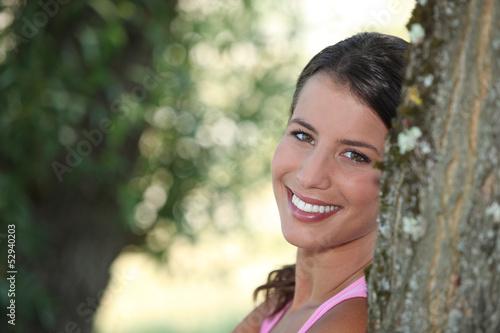 Girl relaxing under tree
