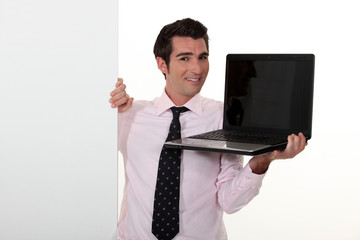 Man in smart suit showing notebook