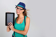 Funny trendy girl showing tablet screen