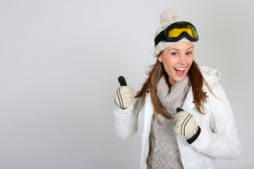 Skier woman showing thumbs up