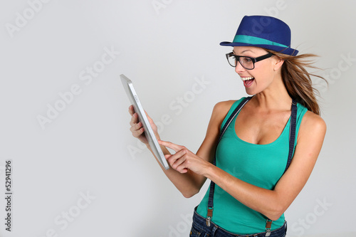 Girl with hat websurfing with tablet