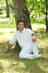 Man sitting under a tree