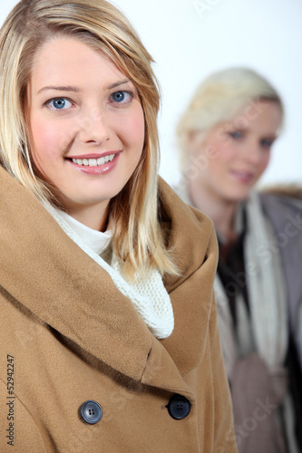 Two women dressed in winter clothing