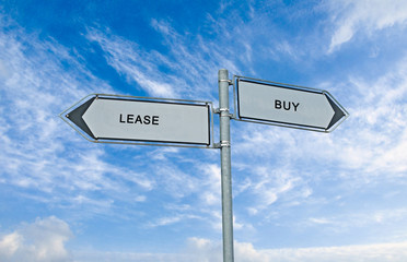 Road sign to lease and buy
