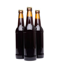 Three bottles of beer on white background.