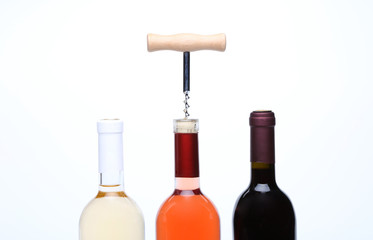 A set of three kinds of wine and corkscrew