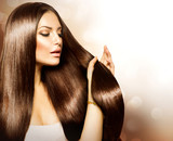 Beauty Woman touching her Long and Healthy Brown Hair - 52942854