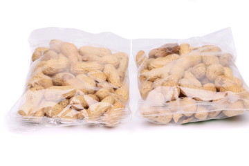 Two large plastic bags of peanuts