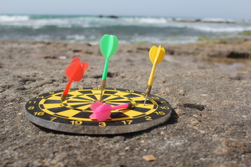 Arrows in a target board, at the beach