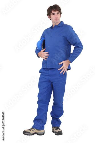 Confident builder posing