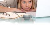 Woman peering at her laptop