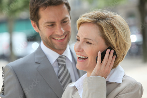 Businessman and woman laughing