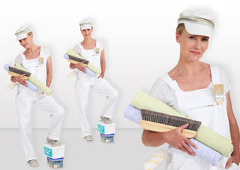 blonde lady carrying rolls of wall paper