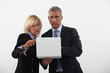 businessman and businesswoman holding a laptop