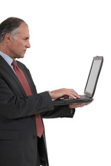 Senior businessman with a laptop