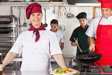 Confident Female Chef In Kitchen