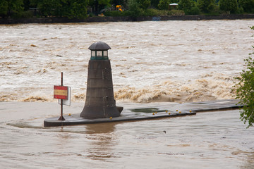 Flood in Prague in 2013. Small beacon in rough Vltava river.