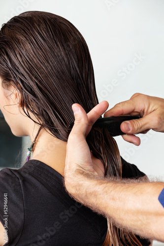 Hairdresser Combing Client's Wet Hair