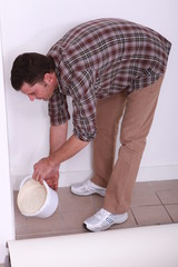 Man pouring plaster