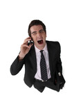 Businessman screaming down the telephone