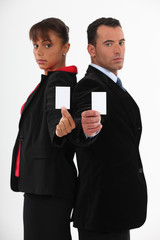 Executives with blank business cards