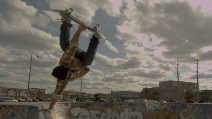 Skateboarder Inverted Handplant
