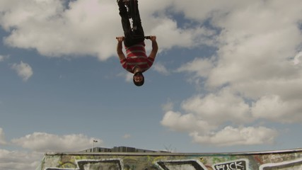 BMXer Backflip Against Sky