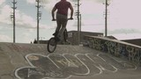 BMX Bike Rider Does Technical Trick