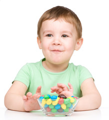 Portrait of a boy with candies