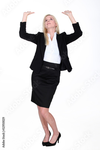 Woman raising arms towards the sky