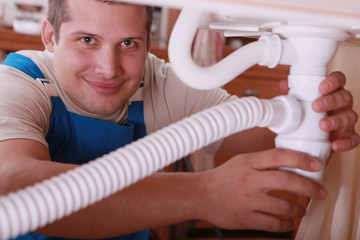 Plumber fitting a kitchen sink