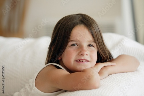 little girl posing on the sofa