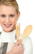 a blonde woman with wooden flatware