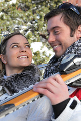 smiling young couple at ski