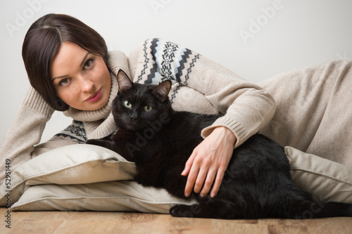 Pretty young woman with her cat