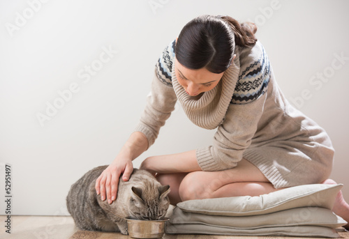 Beautiful young woman and her cat