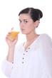 Brunette drinking juice
