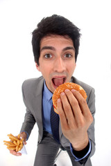 Businessman eating junk food