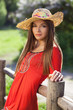 Beautiful woman in a straw hat