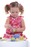 little girl playing at tea party