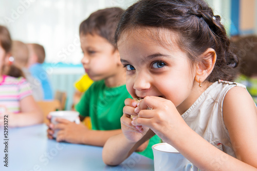 canvas print picture Cute little children drinking milk