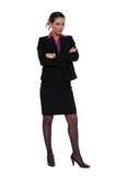 Businesswoman standing cross-armed