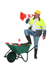 Builder shouting through cone