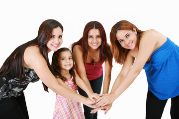 Group of young people with hands together - family concepts